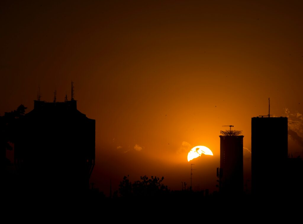 Sunset behind city buildings